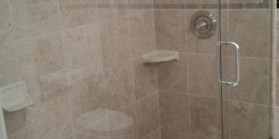 Heavy glass frameless shower door with notch panel